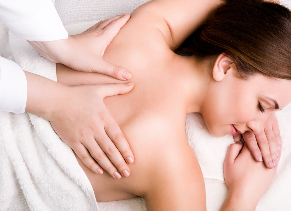 female patient getting back massage